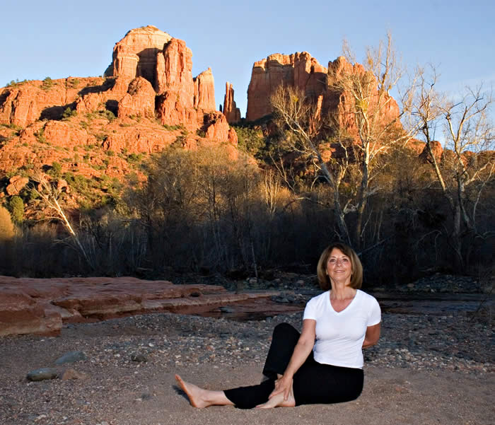 Sedona Spirit Yoga, Hiking and Meditation guide guest to many Sedona vortexes; shown here is Cathedral Rock with Johanna