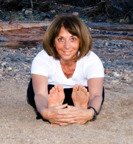 Johanna Maheshvari leads the forward bend and other yoga poses for clients on her Sedona Spirit Yoga & Hiking woman-in-transition retreats