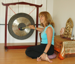 Johanna Maheshvari Mosca leads a gong meditation for a Sedona Spirit Yoga & Hiking woman's retreat