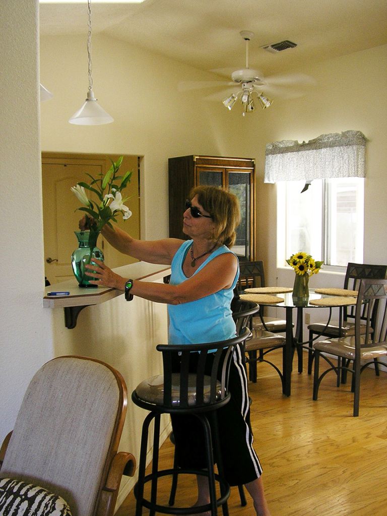 Johanna putting flowers in the dining area