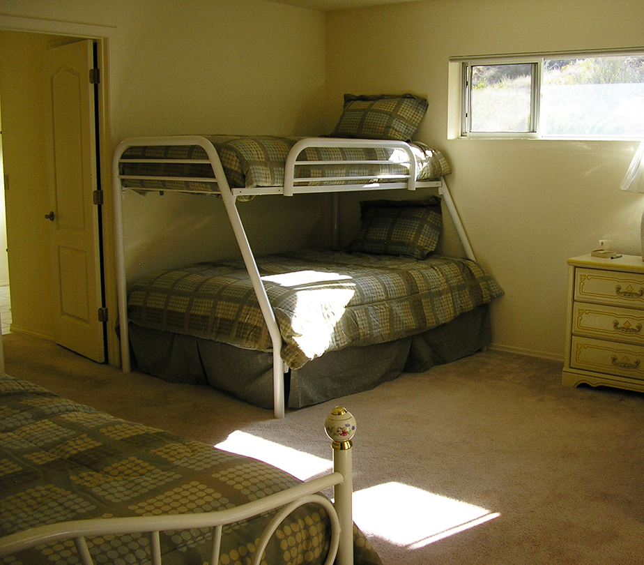 Shared master bedroom with a full bed on right not shown